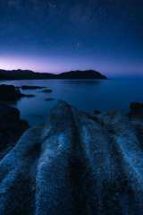 Abel Tasman National Park on the upper end of New Zealand's south island has beautiful beaches and rugged shores. As twilight settled in for the night, and the stars came out, I found a secluded spot to appreciate the scenery.
