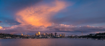 Beautiful clouds light up at sunset over Seattle skyline as seen from Gas Works Park.
