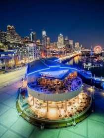 Seattle's waterfront gives a scenic view on the Puget Sound. This is Pier 66 looking down to the great wheel at twilight.