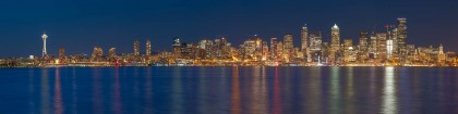 From West Seattle and Alki Beach, one gets a great view of the Seattle Skyline. As twilight followed the sunset, the city lights turne don and reflected in the Puget Sound.