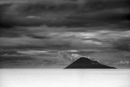 The island of Manado Tua sat off in the distance from my resort. One morning, as the clouds passed by, I set up my tripod for a long exposure to smooth the tropical waters of the South Pacific.