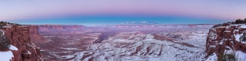 I almost missed the after glow of sunset in Canyonlands. The winter roads caused, and my haste, caused me to slip off the snowy road. A good citizen pulled me out and I headed to an overlook to create this panorama.