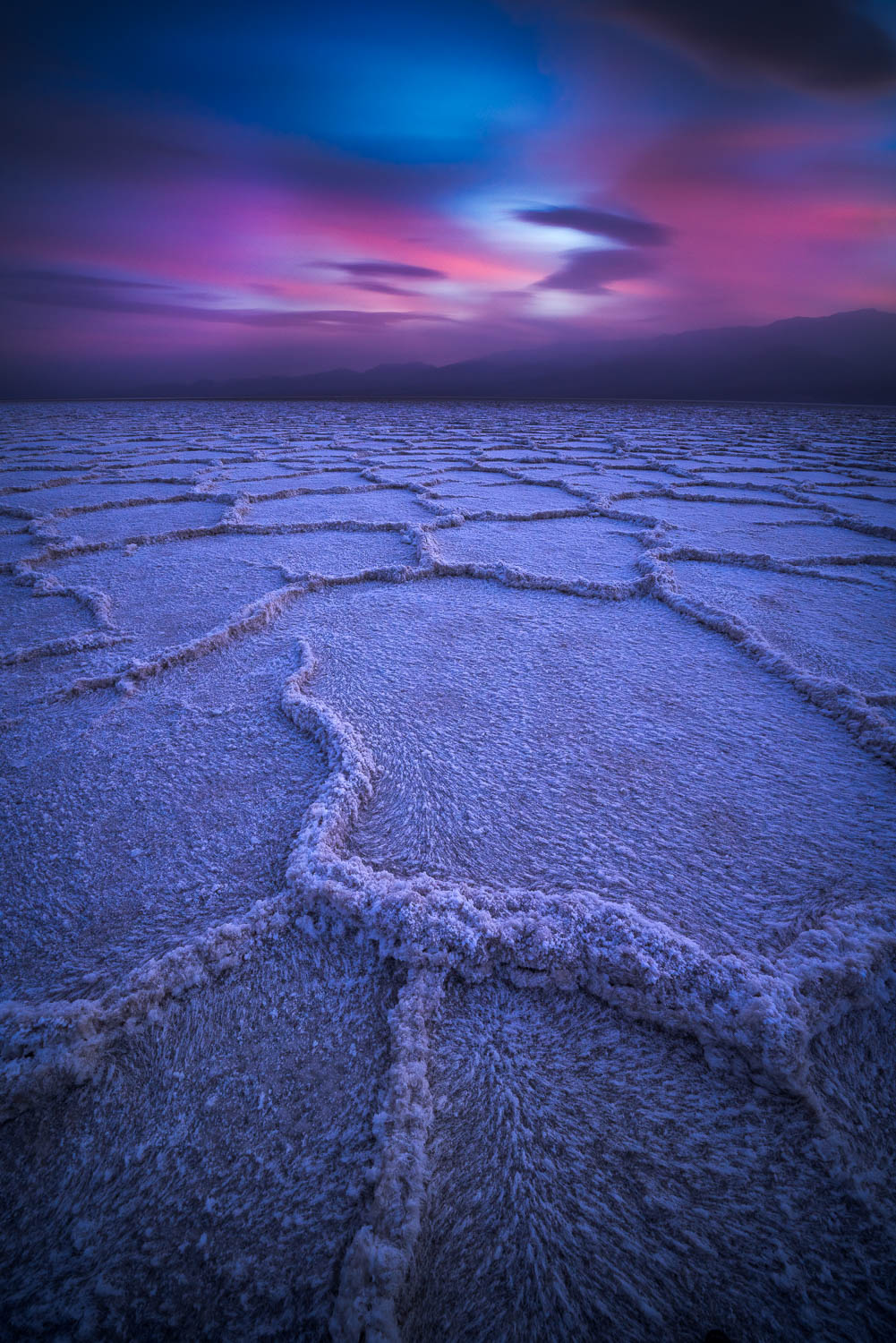 Blue and pink tones over salt flats
