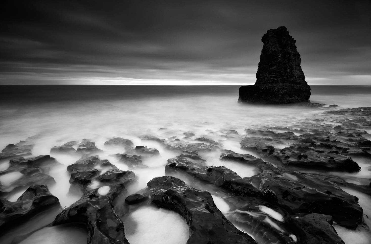 Long exposure stills the ocean waters of the Davenport coast