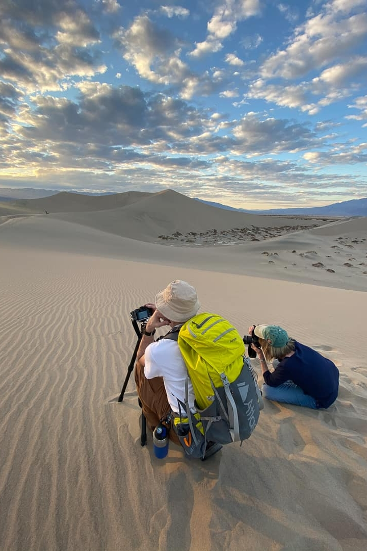 photography workshop participants on sand dunes in Death Valley