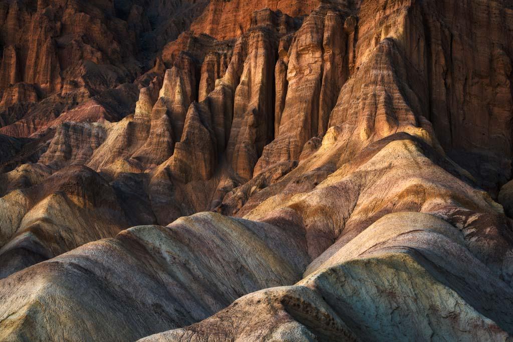 Desert badlands at sunset in Death Valley National Park