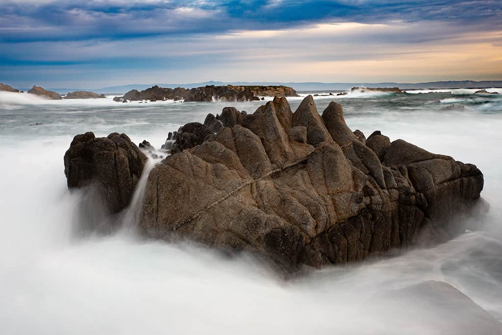 rugged rocks on California Coast with flowing water