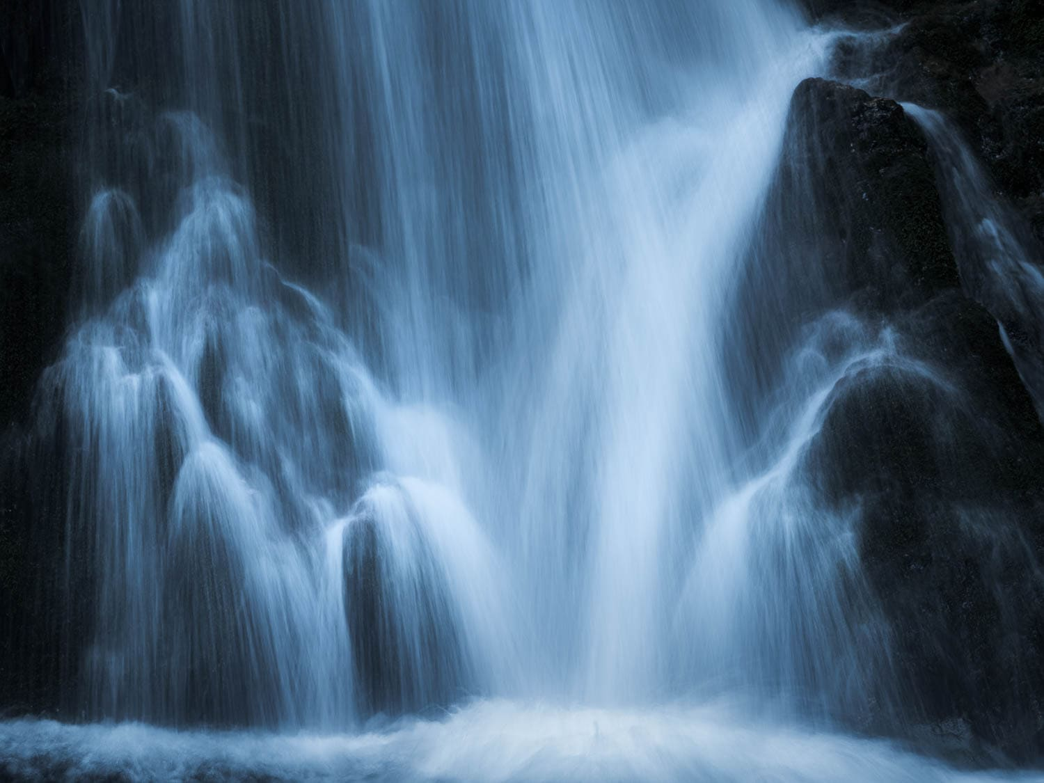 Small detailed section of waterfall with soft blue tones