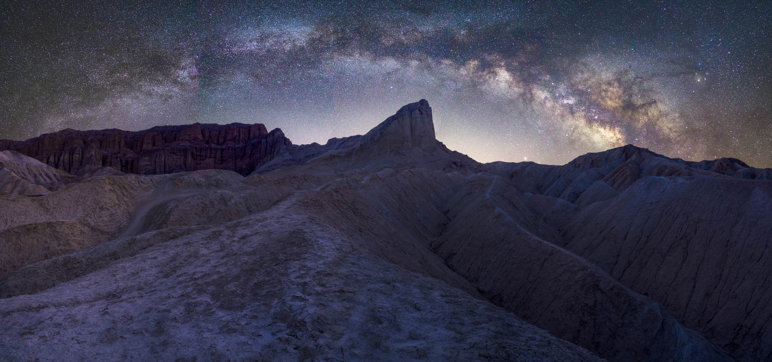 Milky way panorama over desert badlands