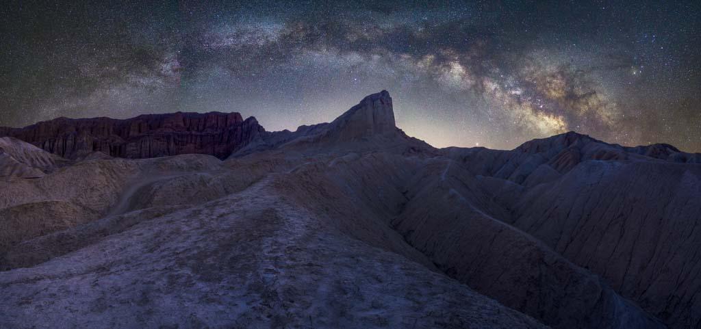 Milky way panorama over desert badlands