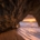 Natural rock arch along central California coast at sunset
