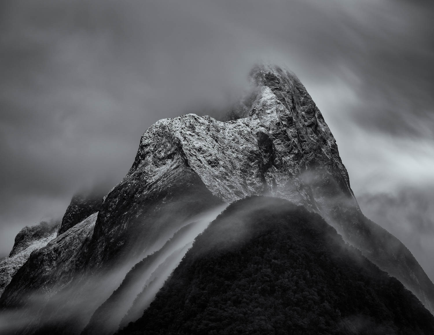Clouds flow over Mitre Peak in Milford Sound