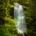 Waterfall among green rainforest