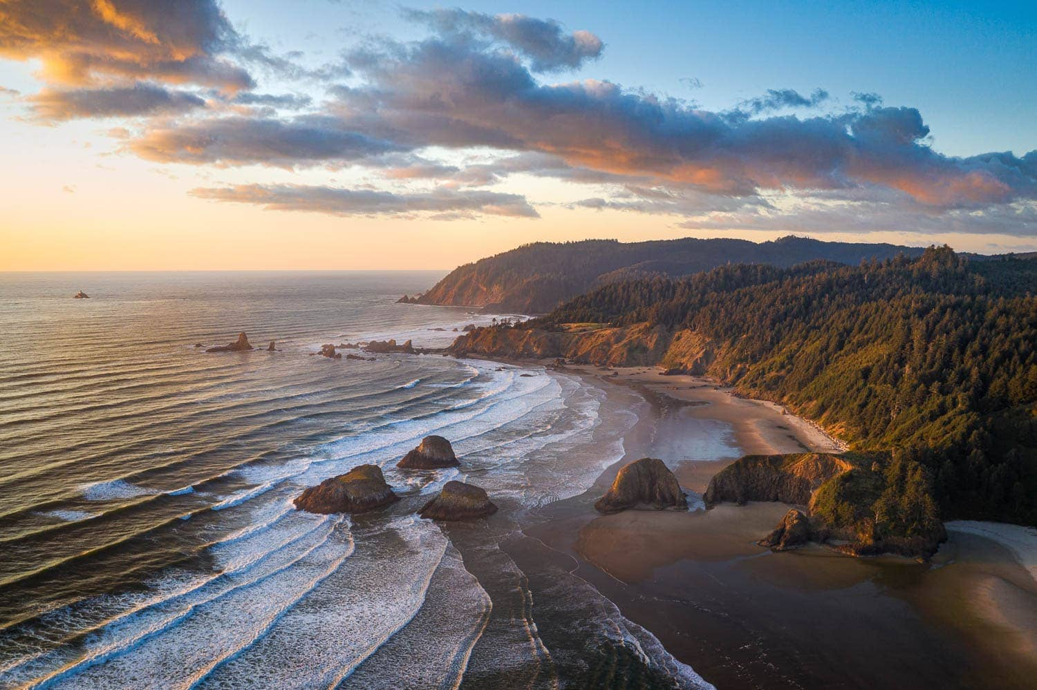 Aerial photo of the rugged Oregon Coast at sunset