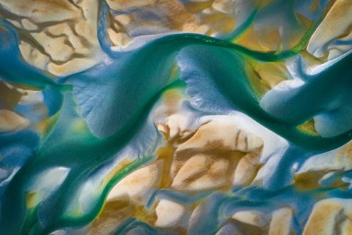 Aerial photo of river delta at low tide with turquoise waters